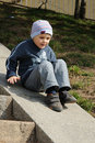 Boy on steps Stock Photo