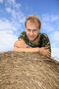 Boy on straw bale Royalty Free Stock Photos