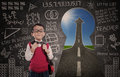 Boy student and road to success through a keyhole with written blackboard Royalty Free Stock Photos