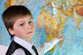 The boy is studying the  map of the world Royalty Free Stock Photo