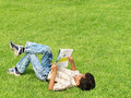 Boy Studying Outside Royalty Free Stock Photo