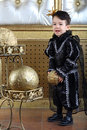 Boy in a suit of black prince holding ball the golden Stock Photos