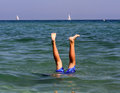 Boy on summer holidays active swimming in the sea water Royalty Free Stock Photos