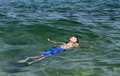 Boy on summer holidays active swimming in the sea water Royalty Free Stock Image