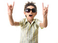 Boy in sun glasses showing rock sign cute teen isolated on white background Royalty Free Stock Image