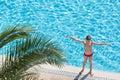 Boy sunbathe on the edge of the pool Royalty Free Stock Photo