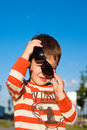 Boy with sunglasses little outdoor Royalty Free Stock Image