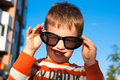 Boy with sunglasses smiling in outdoors Stock Photography