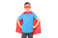 Boy in a superhero costume posing isolated on white background Royalty Free Stock Image