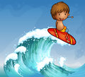 A boy surfing in the waves Royalty Free Stock Photo