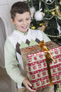 Boy is surprised with a big christmas gift young Stock Photos