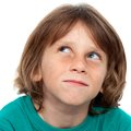 Boy with surprising face expression. Stock Image