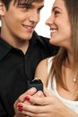 Boy surprising girlfriend with diamond ring. Royalty Free Stock Photography