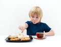 Boy with sweets Royalty Free Stock Photos