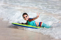 Boy swimming on boogie board Royalty Free Stock Images