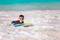 Boy swimming on boogie board Royalty Free Stock Photo