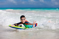 Boy swimming on boogie board little vacation having fun Royalty Free Stock Image
