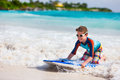 Boy swimming on boogie board little vacation having fun Stock Image