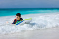 Boy swimming on boogie board little vacation having fun Royalty Free Stock Photos