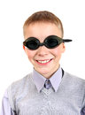 Boy in swimming goggles isolated on the white background Stock Photos