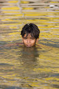 Boy swimming in the Holy River Ganges - India. Stock Photos