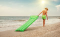 Boy with swimming mattress walks on sand sea beach Royalty Free Stock Photo