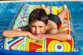 Boy in swimming pool Stock Image