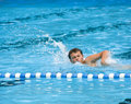Boy swimming in pool Royalty Free Stock Photo