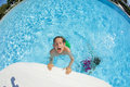 Boy swimming in the pool cute Stock Photography
