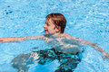 Boy swimming in the pool cute Royalty Free Stock Image