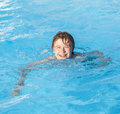 Boy swimming in the pool cute Stock Images