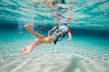 Boy swimming underwater back view of a cute little Stock Photos