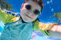 Boy swimming underwater portrait of a cute little Stock Photography