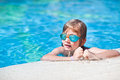 Boy at swimmingpool happy in wears swimmgoggles Royalty Free Stock Image