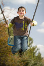 Boy on swing Royalty Free Stock Photos