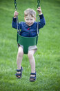 Boy in swing Stock Images