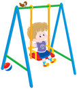 Boy on a swing little friendly smiling and swinging Royalty Free Stock Image