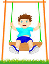 Boy on swing in the park Royalty Free Stock Photo