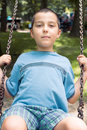 Boy on a swing portrait of Royalty Free Stock Photo