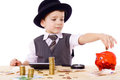 Boy at the table counts money Royalty Free Stock Image