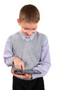 Boy with tablet computer cheerful using isolated on the white background Royalty Free Stock Photo