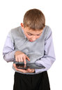 Boy with tablet computer surprised kid isolated on the white background Stock Image