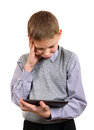 Boy with tablet computer troubled isolated on the white background Stock Image