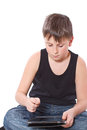 Boy with a Tablet PC Royalty Free Stock Photography