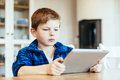Boy with tablet playing ipad or Stock Photo