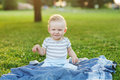 Boy take rest baby in summer park Stock Photography