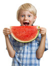 Boy taking bite of water melon a cute happy smiling about to take a juicy slice watermelon isolated on white Royalty Free Stock Photo