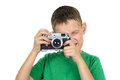 Boy taking photos by vintage camera smiling little caucasian isolated on white Stock Image