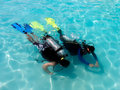 A boy taking scuba diving lessons. Stock Images