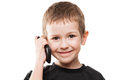 Boy talking mobile phone little smiling hand holding or smartphone white isolated Stock Images